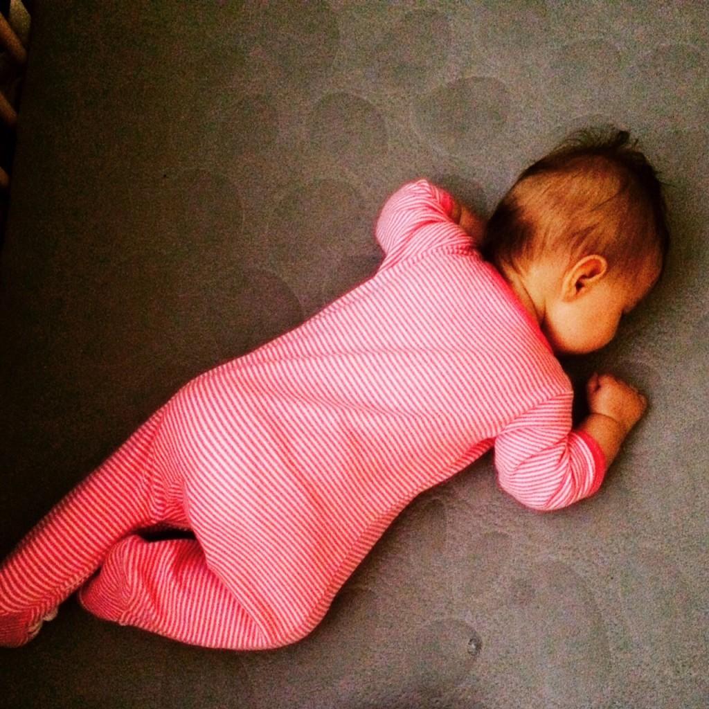 Baby sleeping in crib - sleep deprivation