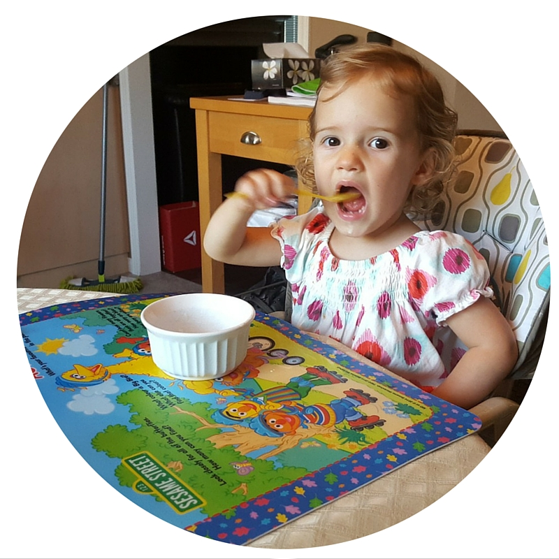 Toddler eating by herself